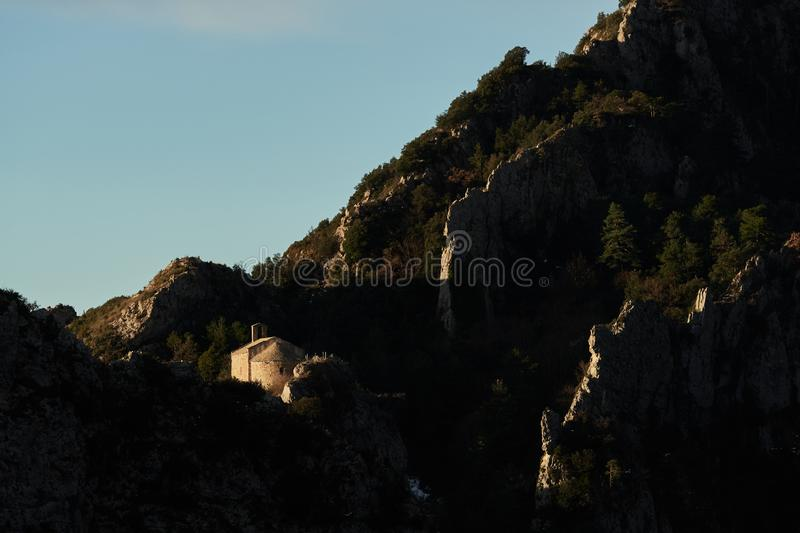 Hermitage in the middle of the abrupt mountain. With the first lights of the day stock photography