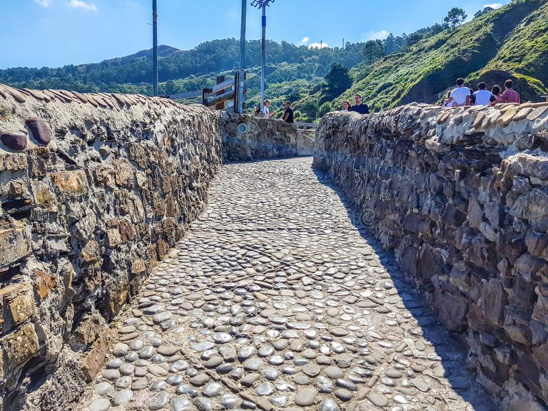 Hermitage of San Juan de Gaztelugatxe at the top of the island of Gaztelugatxe. Vizcaya, Basque Country Spain. View of the. Stairs to ascend royalty free stock images