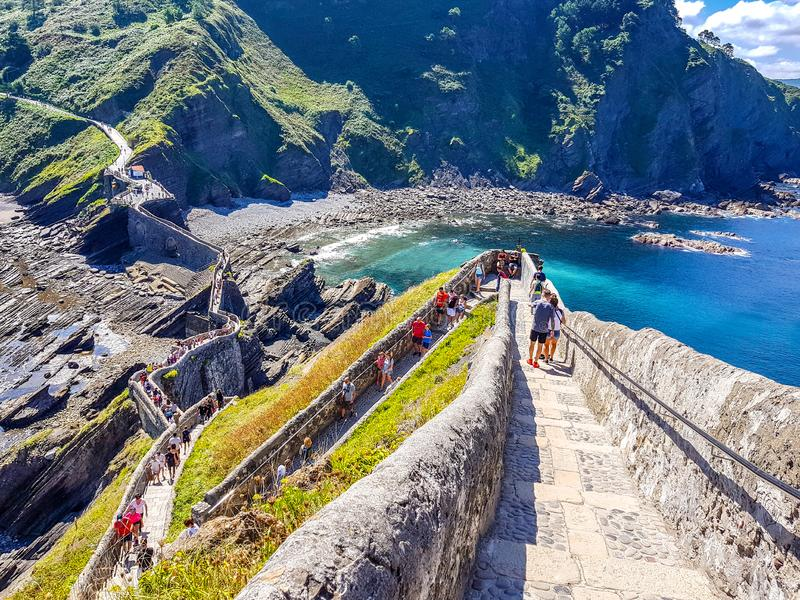 Hermitage of San Juan de Gaztelugatxe at the top of the island of Gaztelugatxe. Vizcaya, Basque Country Spain. View of the. Stairs to ascend royalty free stock photo