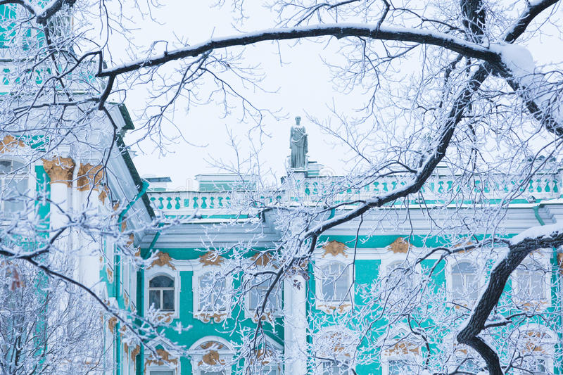 Hermitage through the trees. View of the Hermitage through the trees of the garden of the Winter Palace in winter in St.Petersburg royalty free stock photography