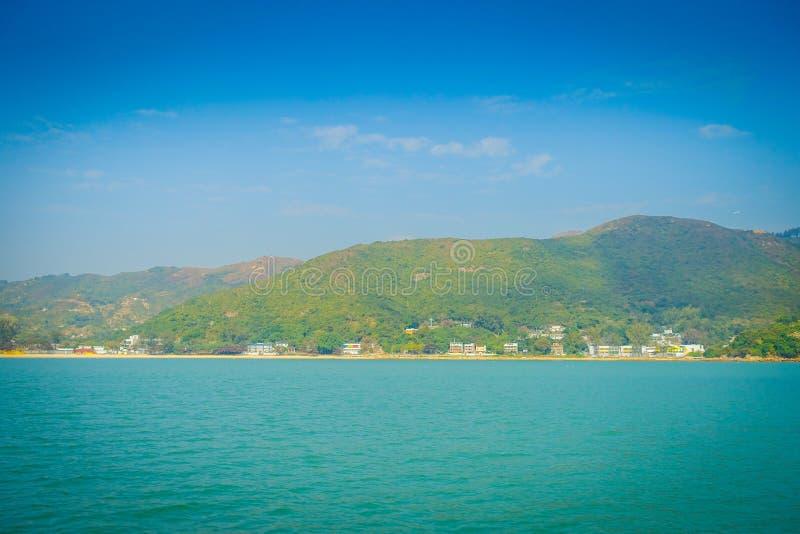 Hermosa vista de la ciudad del wo del mui en el horizonte en la ciudad rural, situada en la isla de lantau de Hong-Kong fotografía de archivo