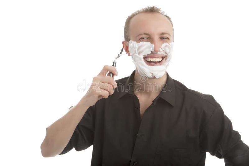 Hermoso feliz con la maquinilla de afeitar fotografía de archivo