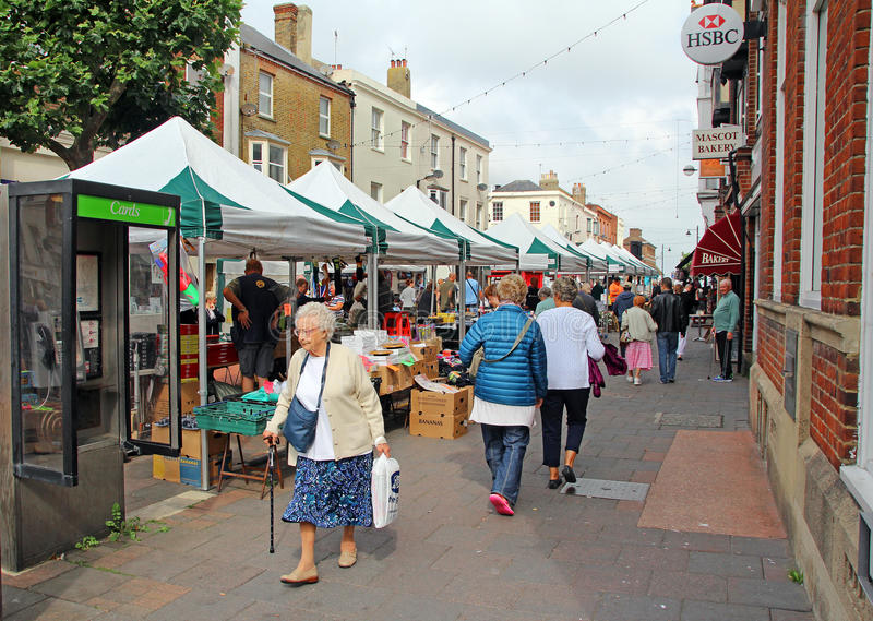 Herne bay market day. Photo of busy herne bay market day showing stall holders and traders selling their goods.photo taken on 13th september 2014 and ideal for royalty free stock photo