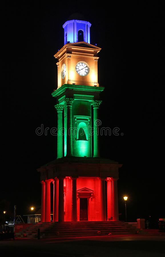 Herne bay victorian clock tower illuminated. The Clock Tower, Herne Bay, is a Grade II listed landmark in Herne Bay, Kent, England built in 1837. It is believed royalty free stock photo