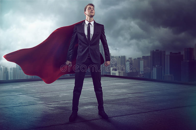 Hero with Cape. On a skyscraper royalty free stock photo