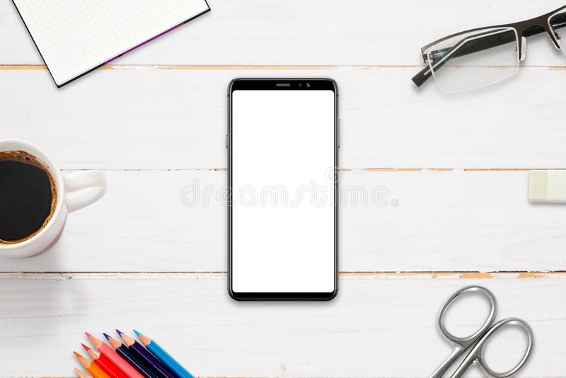 Hero header image on work desk with modern smart phone with isolated display for mockup, app, web site presentation. Flat lay, top view royalty free stock photos