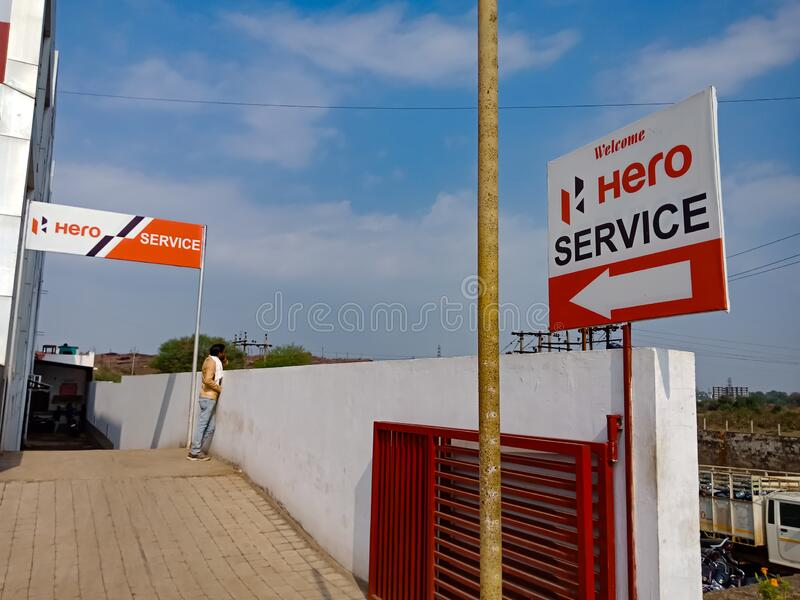 Hero motorcycle service center direction board isolated on blue sky background in india January 2020 royalty free stock image