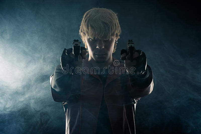Hero with pistols in hands aiming royalty free stock images