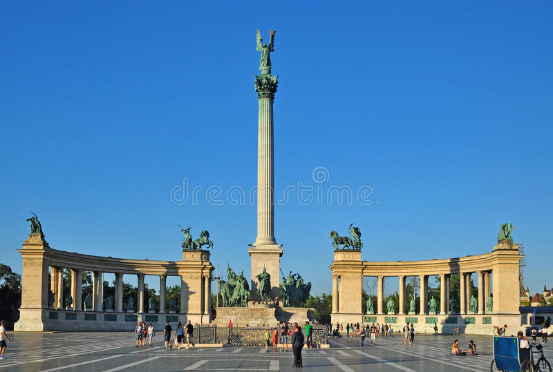 Heroes square Budapest. Heroes square, historical column with archangel Gabriel statue, architectonic monument, Budapest, Hungary royalty free stock photography
