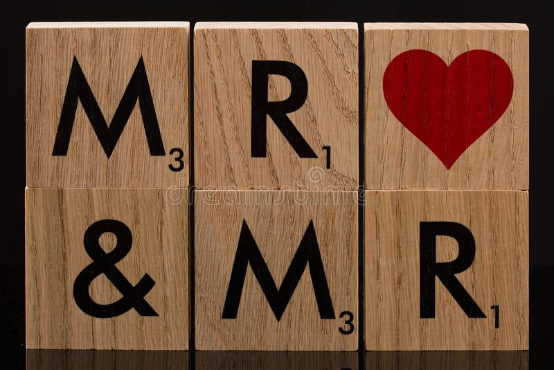 Herr och tegelplattor för Herr Wooden Block arkivfoton