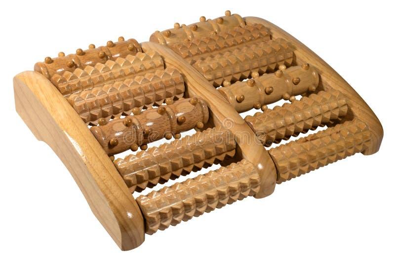 Herramienta de madera del masaje del rodillo para los pies aislados en blanco fotografía de archivo libre de regalías