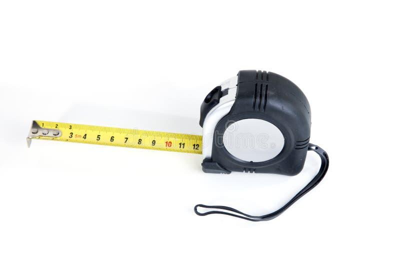 Herramienta de medición en un fondo blanco fotografía de archivo