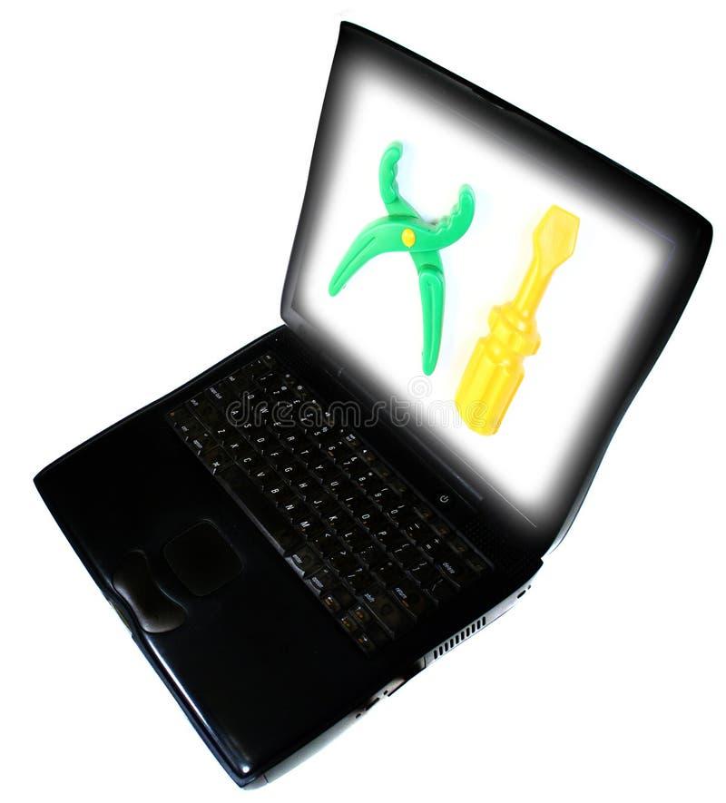 Herramientas de la computadora portátil fotos de archivo
