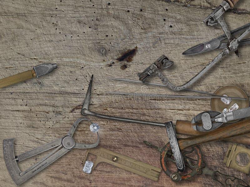 Herramientas del joyero del vintage sobre banco de madera imagen de archivo