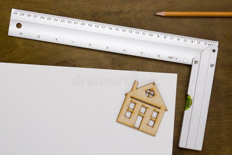 Herramientas modelo de la casa y de dibujo fotografía de archivo