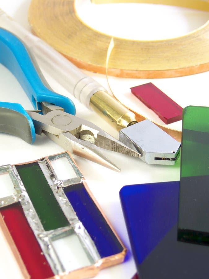 Herramientas para el cristal de colores imagen de archivo