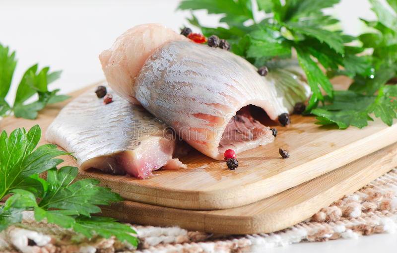 Herring. On a wooden table stock photo