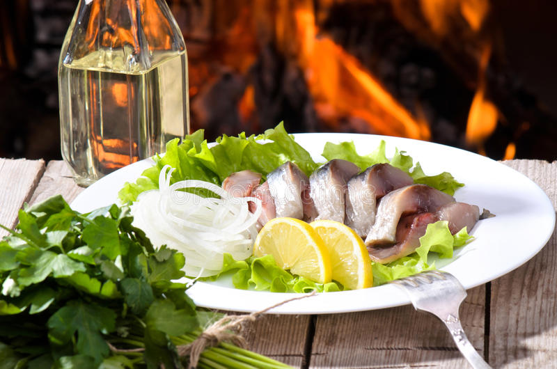 Herring. On a background of fire royalty free stock photography
