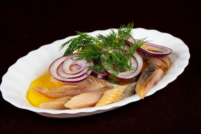 Herring fillet with potato royalty free stock image