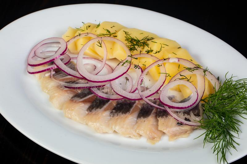 Herring fillet with potato royalty free stock photography