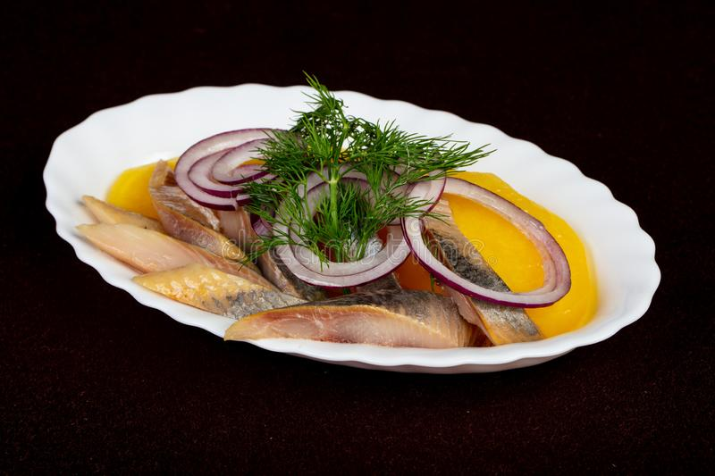 Herring fillet with potato stock images