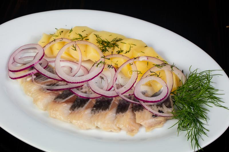 Herring fillet with potato stock image