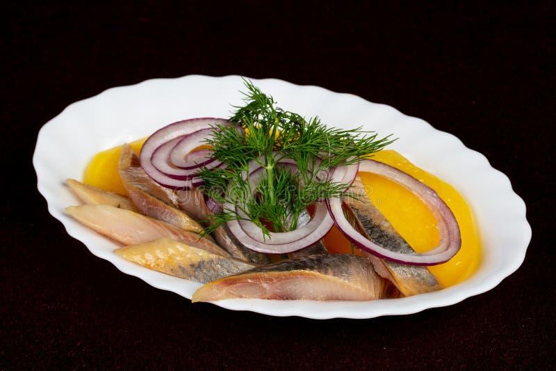 Herring fillet with potato royalty free stock photos