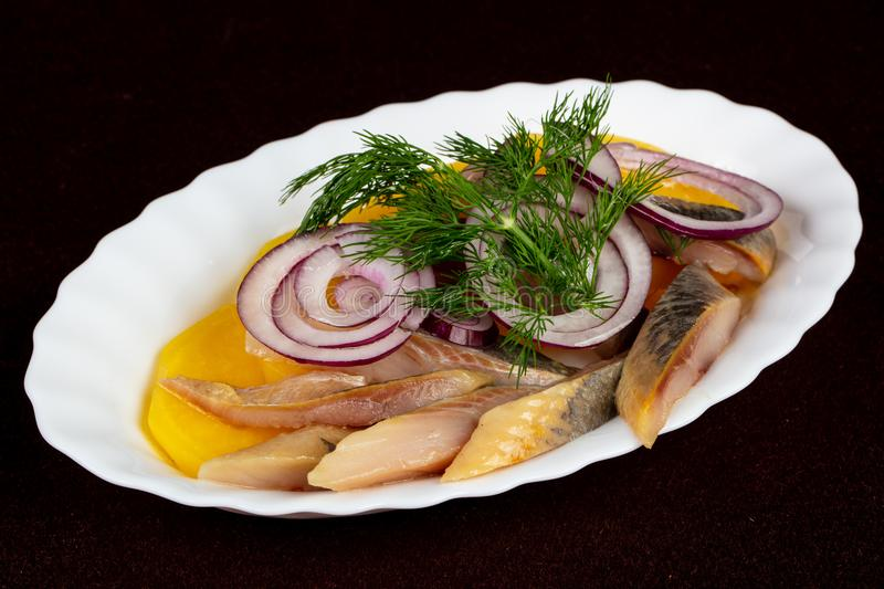 Herring fillet with potato royalty free stock photos
