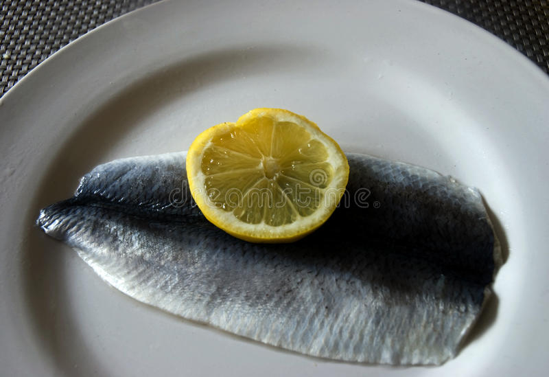 Herring with lemon stock photo