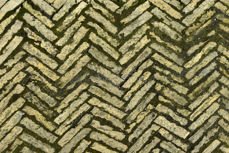Herringbone texture. Old briick paving in herringbone zigzag pattern, texture royalty free stock photography