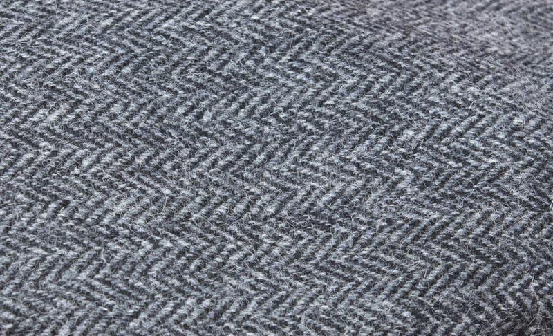 Herringbone Tweed Pattern texture in Grey/Dark Grey/Black made of Harris Tweed. Herringbone Tweed Pattern texture in Grey/Dark Grey/Black made of the Harris royalty free stock photography