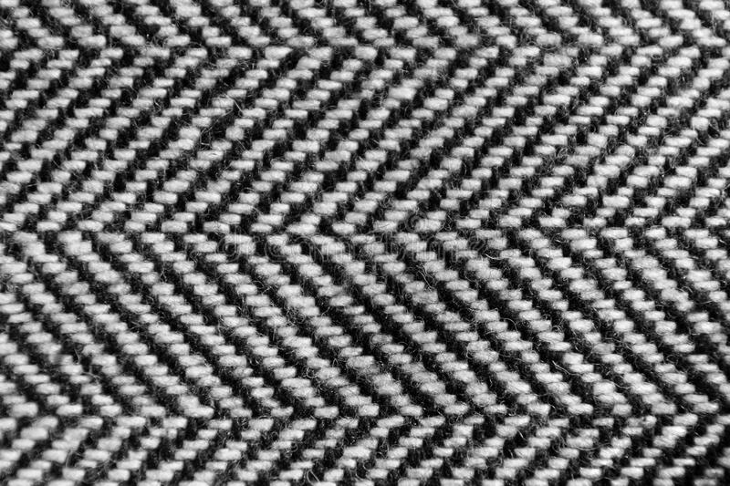 The herringbone tweed wool fabric texture background closeup. Natural organic wool cloth with classic pattern. Material, textile, abstract, clothing, fashion stock image