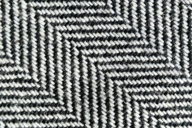 Herringbone tweed wool fabric texture background closeup. Natural organic wool cloth with classic pattern. Material, textile, abstract, clothing, fashion royalty free stock images