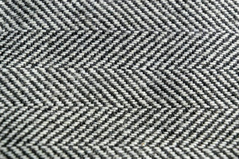 Herringbone tweed wool fabric texture background closeup. Natural organic wool cloth with classic pattern. Material, textile, abstract, clothing, fashion stock photos