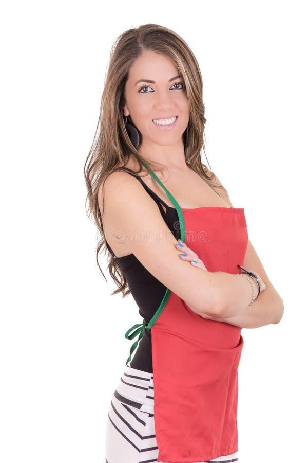Herrliche kochende Frau im Schutzblech lizenzfreie stockbilder