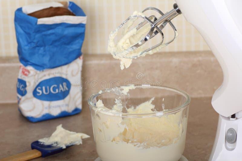 Herstellung der Kuchen-Vereisung stockfotos