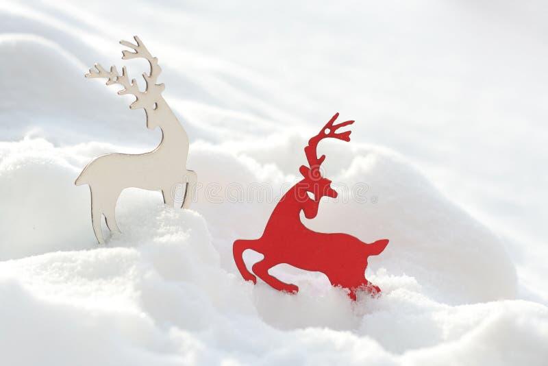 Hertendecor van Kerstmis in de sneeuw De achtergrond van Kerstmis royalty-vrije stock foto's
