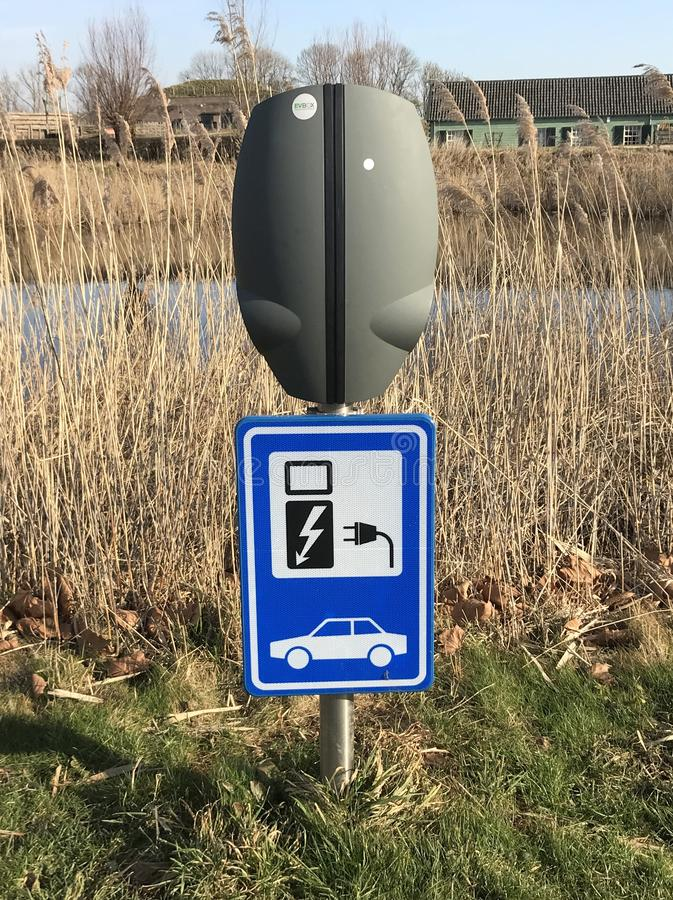 Public electric car charging station. Herwijnen, the Netherlands - February 18, 2019: Public electric car charger stations stock image