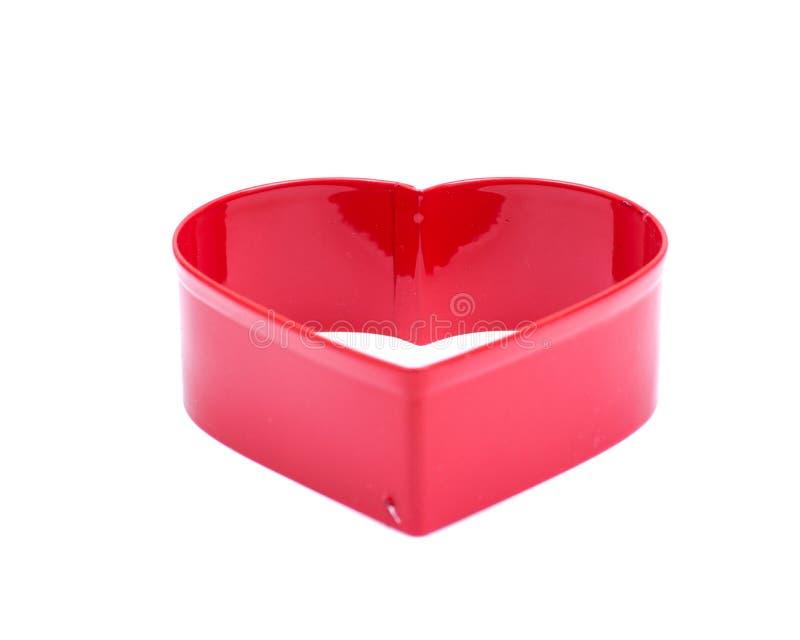 Herz-Form-Höhlen-Kuchen-Schneider-Plastikform für die Plätzchen-Gebäck-Nachtisch-Backen-Verzierung lokalisiert auf Weiß stockfoto