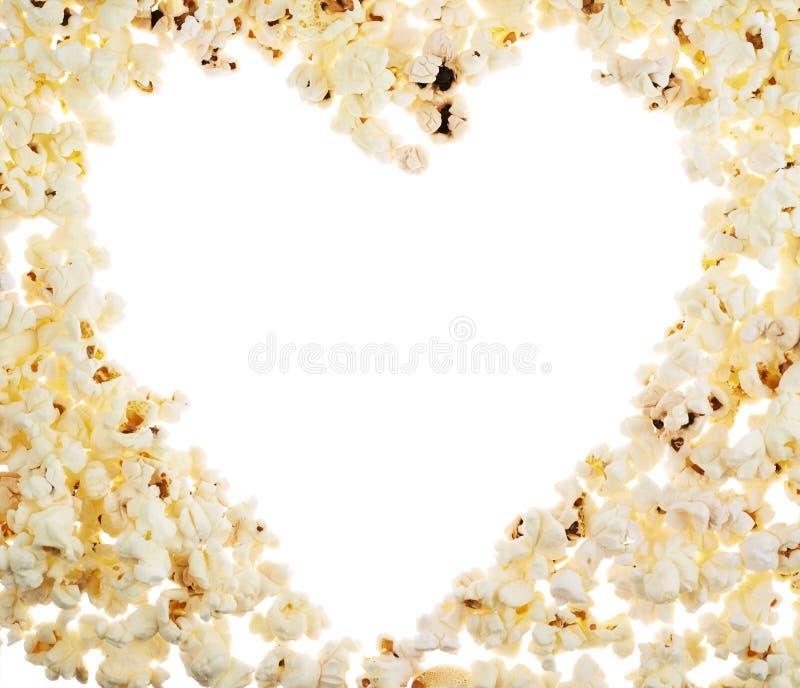 Herz geformter Rahmen gemacht vom Popcorn stockbild