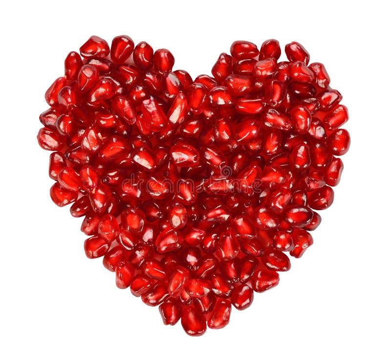 Herz von den Granatapfelsamen stockfoto