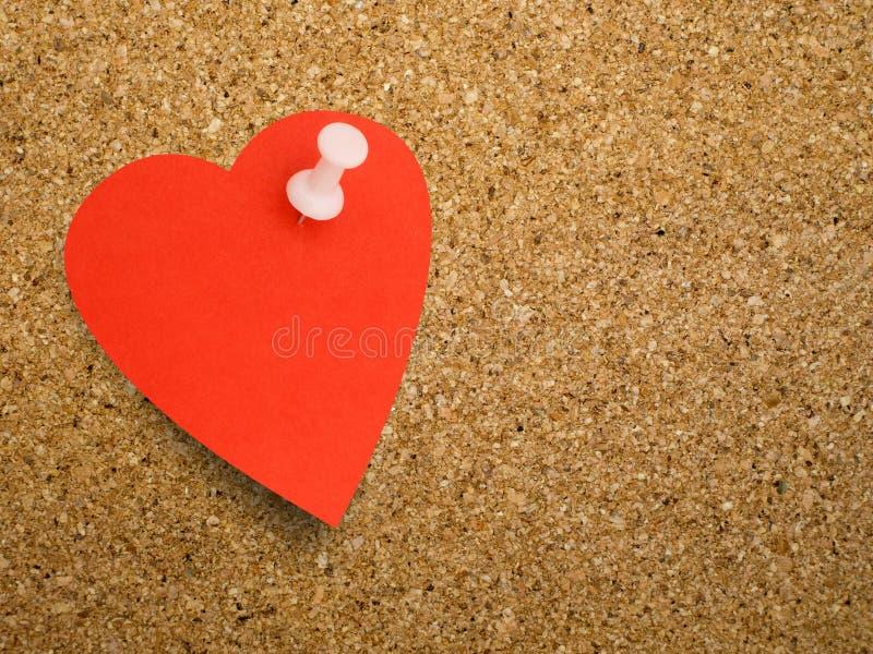 Herzanmerkung, Anzeige auf Korkenbrett backgound - freier Raum für Ihr ich stockbilder