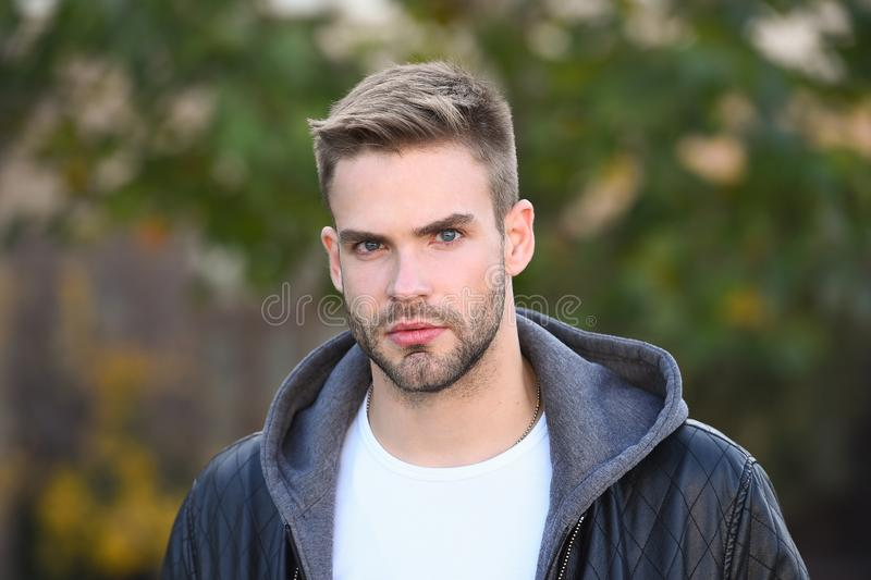 Hes handsome. Handsome man on autumn day. Caucasian guy with unshaven handsome face and stylish blond hair. Confident stock photography