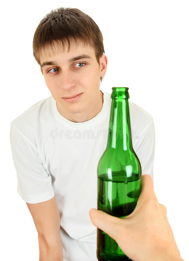 Hesitant Teenager and Beer. On the White Background royalty free stock images
