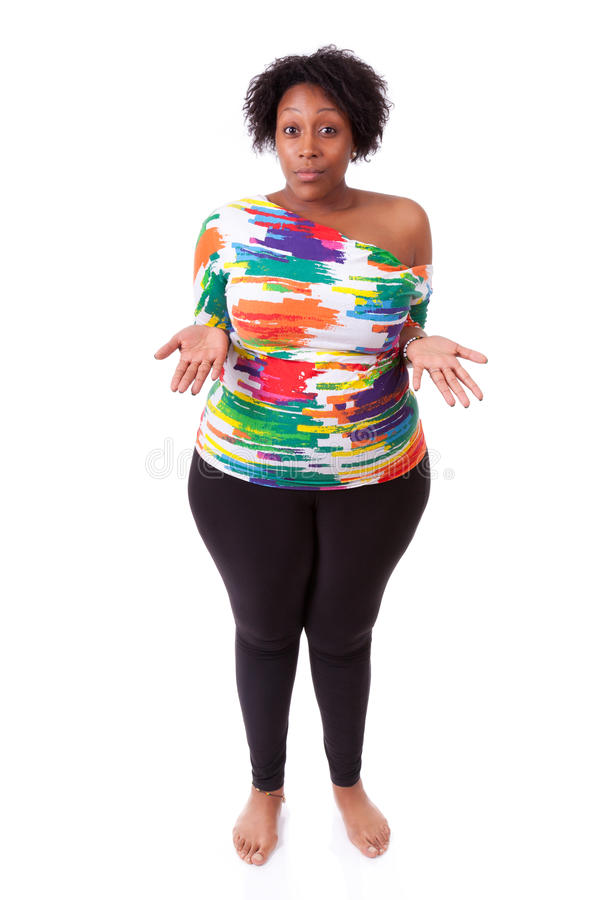 Hesitating young fatty black woman looking up - African people royalty free stock photo