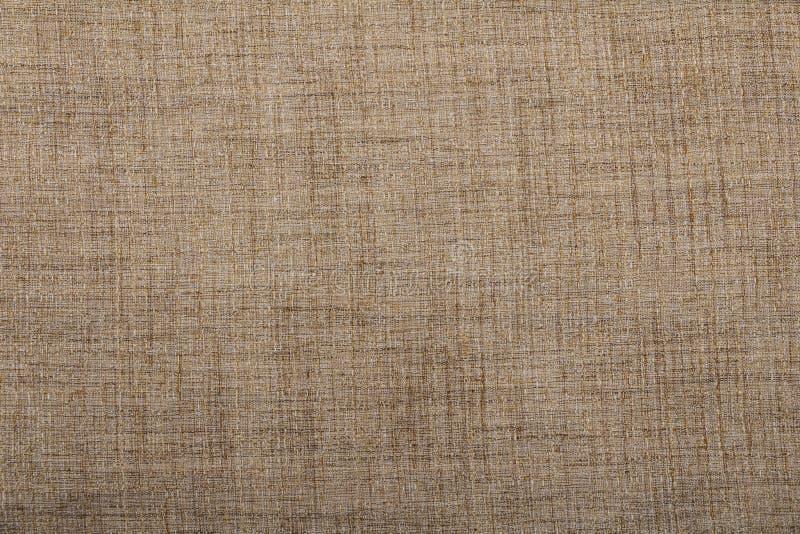 Heski parciany burlap wyplatający tekstury tło, bawełna wyplatający tkaniny tło z flecks zmieniać kolory/beż i brew obraz royalty free
