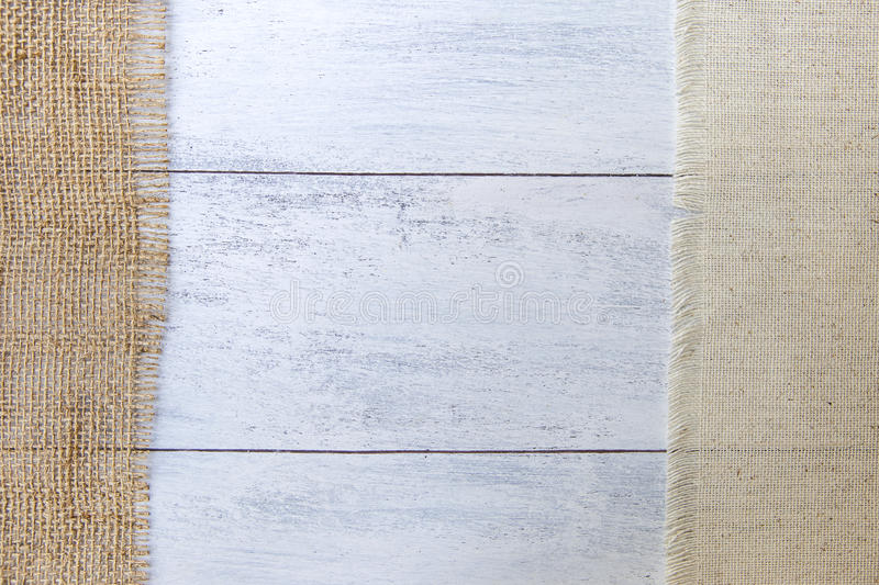 Hessian and canvas fabric on white wood texture. Background stock photo
