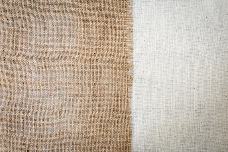 Hessian fabric texture over canvas texture. Background royalty free stock image