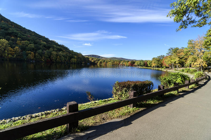Hessian Lake and Foliage near Bear Mountain, NY. Hessian Lake found at the base of Bear Mountain in Rockland County, New York. Seen here is the beautiful blue royalty free stock photos