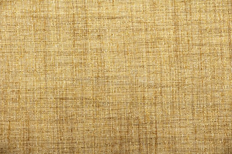 Hessian sackcloth burlap woven texture background / cotton woven fabric background with flecks of varying colors of beige and brow stock photo